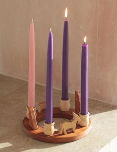 We are also using an advent wreath for the first time this year....this one is really beautiful.  All you really need though is three purple candles, one pink, and one white.