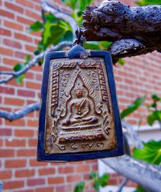 Terra Cotta Buddha Amulet, the Earth Touch mudra represents that through perfect wisdom and mindfulness, the Buddha was able to attain enlightenment under the Bodhi tree