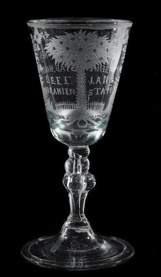 A Low Countries commemorative Orangist baluster goblet, mid 18th century, the round funnel bowl engraved with an orange tree and inscribed LEEF LANG ORANIEN STAM and verso VIVAT. ZYNE. HOODGHEYT. ONSEN. ERF.STAD.HOVDER , supported on a baluster stem and a domed and folded foot, 21.5cm high