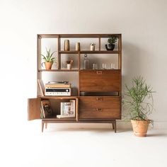 """WEBSTA @ atomic_furnishing - Anyone looking for a media cabinet/bar?!Mid Century JB Van Sciver Wall Unit/Bar with Room for Record Storage (Finished Back), $99560""""x18"""" 70""""HGlass ware by @terraneglass and Home Wares by @bomisch_ #jbvansciver"""