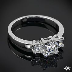 Three Stone Engagement Ring is set in platinum and has been customized to hold two 0.20ct princess sides stones and a 0.704ct A CUT ABOVE® Princess Diamond.