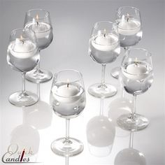 "Set of 36 Wine glasses and 36 2"" Floating candles $99.99"