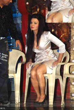 B-town's controversy queen Rakhi Sawant shows off her undies (inset) on the sets of TV show 'Comedy Circus'.