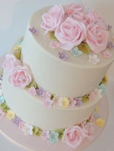 Summer shades wedding cake with rings of flowers - For all your cake decorating supplies, please visit craftcompany.co.uk