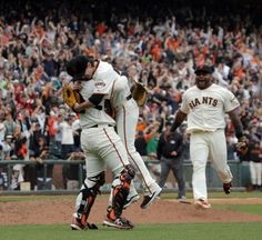 Pitcher Tim Lincecum, center, is mobbed by catcher Hector Sanchez, left, and third baseman Pablo Sandoval after he pitched a no hitter as th...