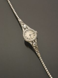 Art Deco Lady's Platinum and 4.05 Carat Diamond Quartz Cocktail Wristwatch Circa 1930 Jewelry, Coins & Watches - Sale 1301 - Lot 31 - ADAM A. WESCHLER & SON, INC : AUCTIONEERS AND APPRAISERS - SINCE 1890