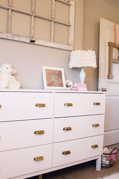 1 IKEA TARVA Dresser, 25 Different Ways | Apartment Therapy - White Nursery Dresser from The Pinto Pony