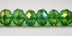 """Green AB Crystal Beads 10x7mm (7x10mm) Green Crystal Rondelle Beads, Faceted Chinese Crystal Glass Beads on a 6 1/2"""" Strand with 24 Beads by BusyBeeBeadSupplies on Etsy Crystal Beads, Glass Beads, Crystals, Abs, Chinese, Jewelry Making, Green, Color, Crunches"""