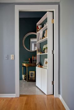 secret door! I wonder if S would let me do this to the bathroom door in our room. Would need little front rails to keep things on the shelves.