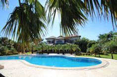 M-096 Luxury mansion with magnificent tropical garden in select community Dominican Republic Real Estate Properties - Luxury Caribbean Villas and Beachfront Properties