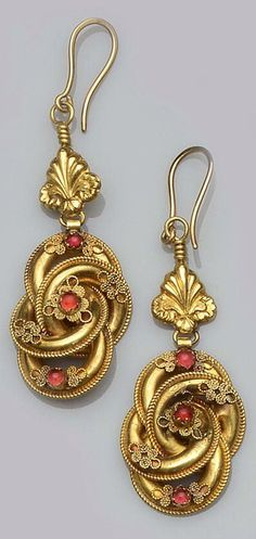 Victorian earrings comprising of a pair of knot design earrings with applied wire decoration and cabochon paste stones