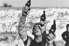 1993 - Boys raise toy guns in a gesture of defiance. The Palestinian uprising, which began in December 1987, strengthened the Arab population in their determination to fight the occupying force. In March Israel closed its border with Gaza, causing a massive rise in unemployment. With more than 800,000 people contained in the Israeli-patrolled, eight-km-wide strip of land, bloodshed increased sharply. The peace agreement signed in Washington on September 13 promised limited authority for the…