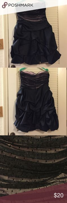 Homecoming dress Great condition. Worn once. Asymmetrical waist. Pick ups in the skirt. Pink and black top. Dresses Prom