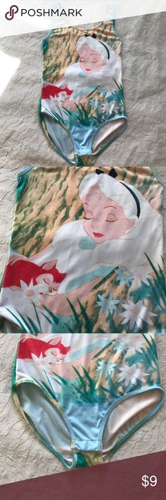 BOGO 50% Off Alice in Wonderland bodysuit An Alice in Wonderland bodysuit from Disney. The suit has two snaps at the bottom. Armpit to armpit is 13.5 inches. Top to bottom is 23 inches. Disney Tops Tank Tops