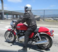 Spotted this gorgeous Triumph when driving in to San Francisco the other day.  I don't know what it is, but I know that I want one!!!  A very sexy red motorbike.  The poor guy riding it probably thought I was checking him out as I stared out the car window.  Sorry, mate... it's your bike that I'm coveting!