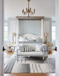 Traditional design and classic decor in a bedroom by Sarah Richardson with tranquil blue grey painted walls, canopy over bed, and blue stripe rug. This is Sarah's own bedroom in her Toronto off the grid house. Coastal Master Bedroom, Master Bedroom Design, Home Decor Bedroom, Bedroom Kids, Modern Bedroom, Serene Bedroom, Glam Bedroom, Master Room, Trendy Bedroom