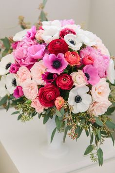 Peonies, ranunculuses, anemones, spray roses, blush veronica, and seeded eucalyptus | Kerinsa Marie Photography & Violet Floral Design | see more on: http://burnettsboards.com/2014/04/sweetest-anniversary-surprise/