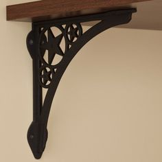 Star Cast Iron Shelf Bracket - Black Powder Coat by Whittington Collection. $18.95. The central star motif of this shelf bracket works well in rooms with a western or nautical theme. This shelf support is made of cast iron, making it a durable and sturdy home accessory. Shown in Rust finish. Bracket dimensions: 9-3/8 L x 9-3/8 H. Bracket is 3/4 wide; 1-3/4 wide where the mounting screws are placed. Made of durable cast iron. Rust finish is actual oxidized iron, a living finis...