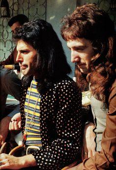 Freddie Mercury and John Deacon of Queen.