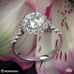 Verragio Round Halo Diamond Engagement Ring - INS-7033 - Verragio Insignia Collection. This designer engagement ring features 0.60ctw of Round Brilliant Diamond Melee (F/G VS) that enhance a round, princess, radiant or square diamond center of your choice. The width tapers from 2.0mm at the top down to 1.7mm at the bottom.