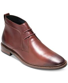 Cole Haan adds a burnished toe to these classic chukka boots for an updated look that's perfect for going out on the town. | Leather upper; manmade sole | Imported | Plain toe  | Lace-up closure with