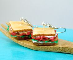 Treat your favorite bacon lover to these delicious BLT sandwich earrings that look just like the real thing. Toasted bread is piled high with crisp