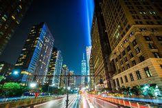 The Battery Park Underpass and 1 World Trade Center with the Tribute in Light, seen at night in Lower Manhattan, New York.