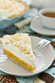 Mango Coconut Cream Pie with almond meal gluten free crust. The mango coconut custard layer combines beautifully with the whipped cream topping.| Roti n Rice