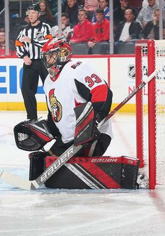 NEWARK, NJ - DECEMBER Mike McKenna of the Ottawa Senators defends his net against the New Jersey Devils during the game at Prudential Center on December 2018 in Newark, New Jersey. (Photo by Andy Marlin/NHLI via Getty Images) Nhl Games, Hockey Goalie, New Jersey Devils, Ottawa, Motorcycle Jacket, December, Baseball Cards