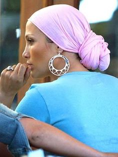 JLo in a head wrap. I remember my grandma used to do this. On the day before she washed her hair, she would drench it in olive oil. slick it back in a low bun, wrap her hair with plastic wrap, then put a beautiful head wrap on. She'd throw on her big gold hoops and shades and walk out the door. She always looked so chic! She'd leave it all day, and then that night she would wash it. She had the softest, shiniest hair.