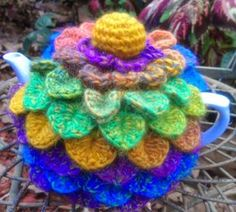 Craft a cure for cancer free tea cosy patterns: Crocodile Stitch Tea Cosy. If colours were browns & earthy tones and big eyes, some ears and a beak were added, this could become an OWL TEA COSY.