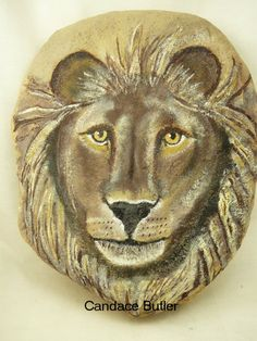 Hand painted rock lions head