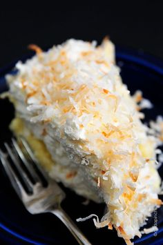 Coconut Cream Pie Recipe ~ A perfectly flaky and delicious pie crust filled with rich, creamy coconut custard layered with mile high whipped cream and topped with toasted coconut.