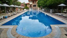 How Much Does a Tile Pool Cost? Ceramic, Stone, Glass