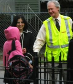 "Governor Chafee greeting a student joining ""The Walking School Bus"" group on the way to school"