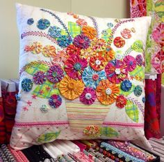 Pillow, colorful, embroidered and yo-yoed!