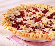 A trio of fruit flavors is a delicious combination in this winning pie recipe. Pastry cutouts on top gives the pie a festive appearance.