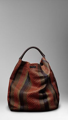 Burberry woven leather and cotton duffle bag.  Sickening!