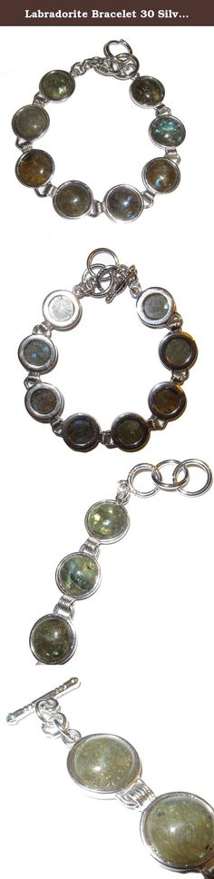 "Labradorite Bracelet 30 Silver Metal Link, Rainbow Flash Gemstone Crystals Adjustable 6.5""-7.25"" (Gift Box). Crystal Jewelry Beautiful labradorite gemstones form an attractive design on your silver metal link bracelet. These stones boast a charcoal gray color, some exhibiting flash rainbows at certain angles of light. The polished beads are secured to a silver toned metal with toggle clasp, adjustable for wrists 6.5""-7.25"". You receive one hand selected bracelet per order from an elite..."