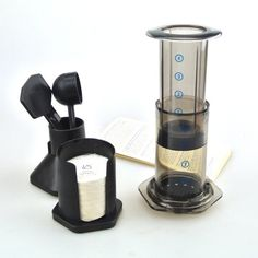 This brilliant, lightweight and portable AeroPress Coffee Maker produces quick, simple and delicious coffee in just 30 seconds. Increasingly popular with coffee Coffee And Espresso Maker, Best Espresso Machine, Coffee To Go, Blended Coffee, Best Coffee, Coffee Maker, Coffee Shop, Aeropress Coffee, Italian Espresso