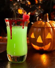 Witch's Brew |  1 and 1/2 bottles champagne, 1/2 gallon of orange juice, 1/2 gallon of lime sherbet, 1/4 c of sugar (optional), 2 liters of Sprite, desired amount of vodka (optional), raspberries for garnish.  Mix the liquids together, then add the sherbet, stirring until there are only a few small chunks of sherbet floating at the top.