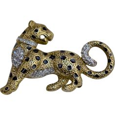 A Vintage Leopard Brooch Pin Of Gilt Enamel Swarovski Crystals from from vespers-smashing-things on Ruby Lane