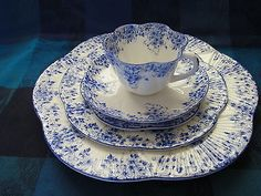 LOVELY 5 PC. PLACE SETTING OF SHELLEY, DAINTY BLUE BONE CHINA.
