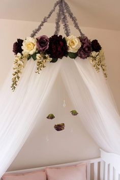 Beautiful and serene crib canopy Purple and white flowers Hanging greenery Dangling roses and crystals Crib canopy Crib crown Crib mobile Shabby chic nursery Shabby Chic crib Shabby chic decor Shabby chic ideas Princess crib Princess nursery Princess decor Purple decor Purple nursery Garden nursery Fairy garden Little girls room Reading nook Reading tent Reading canopy Bed canopy Nursery decor Nursery ideas Nursery themes Baby girl nursery #whiteflowergarden #purpleflowergarden