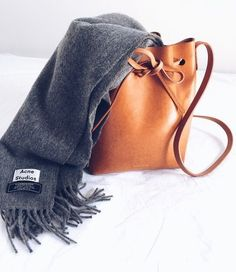 Mansur Gavriel bucket bag and Acne Studios scarf. Minimal Chic, Minimal Classic, Look Fashion, Fashion Bags, Winter Fashion, Womens Fashion, Winter Mode, Outfit Trends, Mode Inspiration