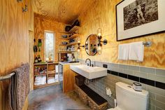 Matt Garcia Design has joined the tiny home movement with the creation of 350 square feet cabins at the Llano River, tucked 70 miles west of Austin. This is sustainable living at its finest. Rustic Cabin Bathroom, Cabin Bathrooms, Industrial Bathroom, Industrial House, Rustic Industrial, Basement Bathroom, Open Bathroom, Industrial Stairs, Industrial Windows