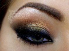 https://www.makeupbee.com/look.php?look_id=26341  Beautiful Arabian-inspired look! Dramatic but wearable :)