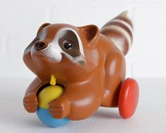 Hey, I found this really awesome Etsy listing at https://www.etsy.com/listing/205265776/vintage-1970s-fisher-price-raccoon-pull