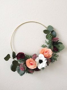 This cool, modern floral/flower wreath comes on a 12 gold metal hoop base with faux/silk/artificial mini Allium, orange Roses, burgundy Ranunculus, Anemone and greenery. Perfect Spring decor, for door hanging or wall hanging in entryway, living room, dinning room, kitchen. Perfect as a