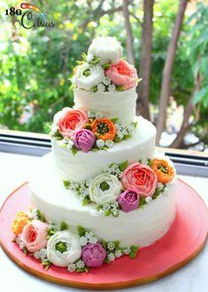 Oriental Buttercream Tiered Cake by Joonie Tan - http://cakesdecor.com/cakes/215805-oriental-buttercream-tiered-cake